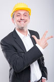 Portrait of handsome engineer showing number three gesture Stock Images
