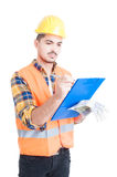 Portrait of handsome engineer using clipboard to write something Stock Photo