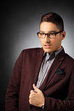 Handsome and fashionable young man posing. Portrait of a handsome and fashionable young man posing Stock Photo
