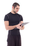 Portrait of handsome fitness trainer in sportswear with clipboar Royalty Free Stock Photos