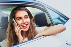 Handsome woman sitting in a car. stock images