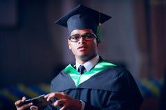 Portrait of graduate student on graduation ceremony stock image