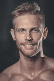 Portrait of a handsome guy on a background of gym Royalty Free Stock Photo