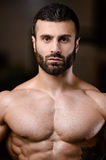 Portrait of a handsome guy on a background of gym Royalty Free Stock Photos