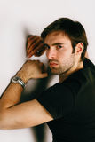 Portrait of handsome guy in a black T-shirt and watch on a hand stock photos