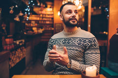 Portrait of handsome guy is holding coffee cup.  Stock Photography