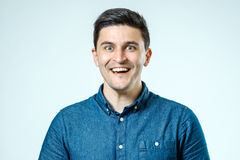 Portrait of handsome guy smiling at camera Royalty Free Stock Photography