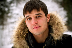 Portrait of the handsome guy in snow Royalty Free Stock Images