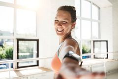 Portrait of handsome happy woman practice yoga exercises indoor sunny loft gym royalty free stock images