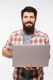 Portrait of handsome hipster bearded man with laptop  in hands Stock Photo