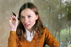 Writer thinking inspiration ideas write idea. book, artist creativity. Portrait of handsome intelligent Woman female freelance writer journalist with an ink pen Stock Image