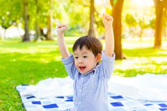 Portrait handsome little boy. Attractive handsome preschool or toddler boy act like a getting victory or win by raise arms up. Cut royalty free stock photos