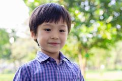 Portrait handsome little boy. Attractive handsome young boy feels happy when cute kid go to outdoor. He is 3 years old. Little royalty free stock image
