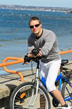Portrait of handsome male with bicycle Stock Images