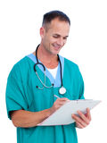 Portrait a handsome male doctor writing notes Stock Photography