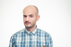 Portrait of handsome male in plaid shirt with raised eyebrow. Portrait of handsome young male in plaid shirt with raised eyebrow isolated over white background Stock Photography