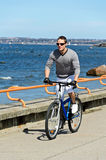 Portrait of handsome male riding a bicycle Royalty Free Stock Images