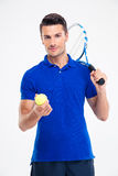 Portrait of a handsome male tennis player. Standing isolated on a white background and looking at camera Stock Photography