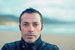 The portrait of Handsome man. On the winter sea Royalty Free Stock Photo