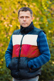 Portrait of handsome man in autumn park Royalty Free Stock Images