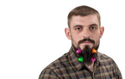 Portrait of handsome man with beard adorned in hair clips is on royalty free stock image