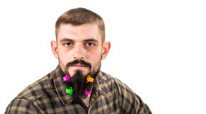 Portrait of handsome man with beard adorned in hair clips is on royalty free stock photos