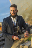Portrait of handsome man with beard. Portrait of young man with long beard and stylish jacket with double-breasted royalty free stock image