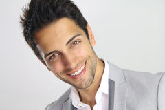 Portrait of an handsome man with a beautiful face smiling Stock Photography