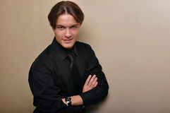 Handsome young man in a black shirt. Male model. Royalty Free Stock Image