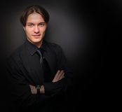 Handsome young man in a black shirt. Male model. Royalty Free Stock Photography