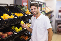 Portrait of a handsome man buying a fruits Stock Photos