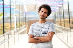 Man with curly hairstyle in urban background Royalty Free Stock Photos