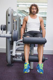 Portrait of handsome man doing leg workout at gym Stock Photography