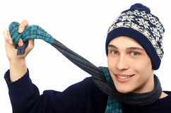 Portrait of a handsome man dressed for a cold winter. Man in sweater with hat and scarf. Stock Photography