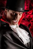 Handsome man dressed in a Dracula costume for Halloween. Royalty Free Stock Photos