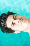Portrait of a handsome man floating on water Royalty Free Stock Image