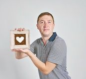 Portrait of a handsome man with heart Royalty Free Stock Photo