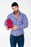 Portrait of a handsome man holding gift box. Isolated on a white background Royalty Free Stock Images