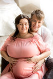 Portrait of handsome man hugging pregnant wife from back Royalty Free Stock Image