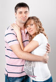 Portrait of handsome man hugging pregnant wife Royalty Free Stock Photography