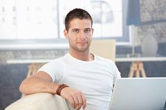 Portrait of handsome man with laptop Royalty Free Stock Photo