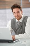 Portrait of handsome man with laptop smiling Stock Photo