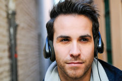 Portrait of handsome man listening to the music Royalty Free Stock Photos