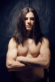 Portrait of handsome man with long hair, torso naked Stock Photos