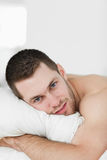 Portrait of a handsome man lying on his belly Royalty Free Stock Photo
