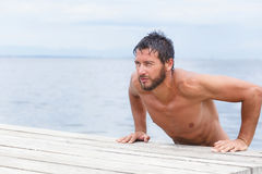 Portrait of Handsome Man with No Shirt at the Sea Royalty Free Stock Image
