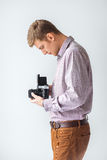 Portrait of handsome man with old medium format camera Royalty Free Stock Images