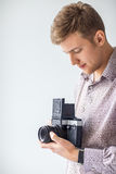 Portrait of handsome man with old medium format camera Stock Photos
