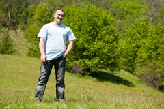 Portrait of a handsome man outdoor in a field Royalty Free Stock Photo