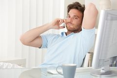 Portrait of handsome man on phone call Stock Image